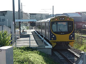 Onehunga Branch - ADL 810 diesel unit at Onehunga Railway Station, with electrification infrastructure partially installed