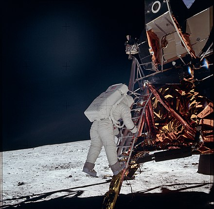 July 20: Neil Armstrong descends a ladder to become the first human to step onto the surface of the Moon during Apollo 11 AS11-40-5868 (21037483754).jpg