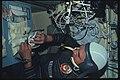 AST-05-271 - Apollo Soyuz Test Project - Apollo Soyuz Test Project, Kubasov opens Food Can in Soyuz - NARA - 16627626.jpg