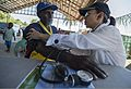 A Project HOPE volunteer, right, checks a man's blood pressure during a Pacific Partnership 2013 health fair in Gizo, Solomon Islands, Aug. 2, 2013 130802-N-GI544-161.jpg