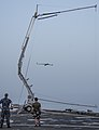 A ScanEagle unmanned aerial vehicle is recovered on the flight deck of the afloat forward staging base USS Ponce (AFSB(I) 15) during International Mine Countermeasures Exercise (IMCMEX) 13 in the U.S. 5th Fleet 130513-N-PX130-093.jpg