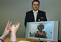 A Video Relay Service session helping a Deaf person communicate with a hearing person via a Video Interpreter (sign language interpreter) and a videophone DSC0051c.jpg