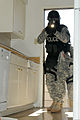 A military police officer with the Special Reaction Team, 178th Military Police Detachment, 89th Military Police Brigade, raids a house in Wainwright Village during a new training exercise at Fort Hood, Texas 130305-A-PK277-833.jpg