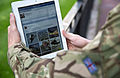 A serviceman accesses social media channels using an iPad, outside MOD Main Building in London MOD 45156043.jpg