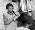 A woman dealing with hair dressing.jpg