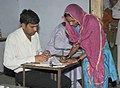 A woman voter registering her name to cast her vote, at a polling booth, during the 6th Phase of General Elections-2014, in Dausa, Rajasthan on April 24, 2014.jpg