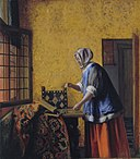 A woman with a pair of scales, by Pieter de Hooch.jpg