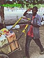 A young Hausa man living off fetching water for people.jpg