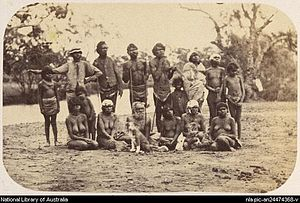 Frederic Bonney - Aborigines at Momba Station by Bonney in the 1870s. Front row (left to right): Jenny (Kalthi Tommy's woman), child, Mary Momba, Old Peter, Polly (Jerry's woman), Wonko Mary and Jenny (who later became George's woman). Back row: Jeannie, Billy, Penchey Martin, Ogle-eyed Johnny, Hughey, Panga (boy), Hughey's woman, Old Mary and Nora.