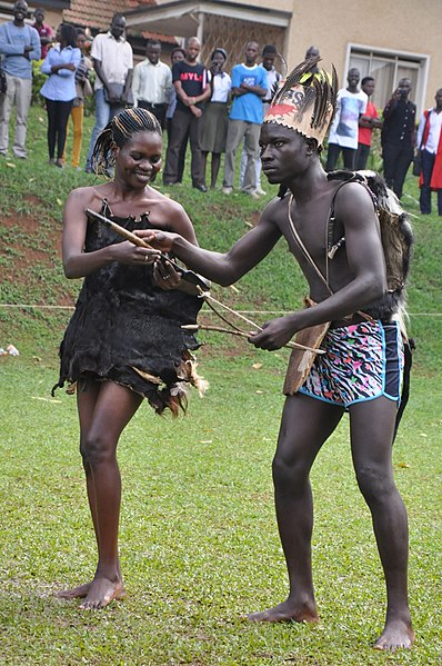 File:Acholi couple in preparation to dance dressed in goats skin and fabric.JPG