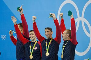 2016 Summer Olympics medal table - The American final team (Adrian, Held, Phelps, and Dressel), after winning the 4 × 100 m freestyle relay at the 2016 Olympics.