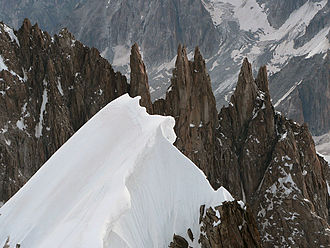 Armand Charlet - The Aiguilles du Diable. Charlet made the first ascent of these pinnacled rock peaks, as well as the first traverse, which included a celebrated move on L'Isolée, the isolated pinnacle just left of centre.