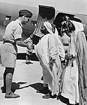 Air Commodore Whitney Straight, Air Officer Commanding RAF Transport Command, Middle East, saying goodbye to the Sheikh Khalifa, cousin of the ruler of Bahrain, and his two sons, 18 January 1945. CM6013.jpg