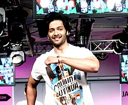 Ali Fazal looking walking on a stage