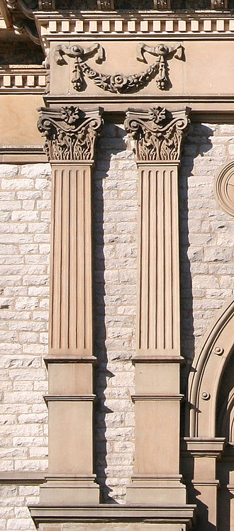 Pilaster - Paired Corinthian pilasters with high bases on the county courthouse in Springfield, Ohio.