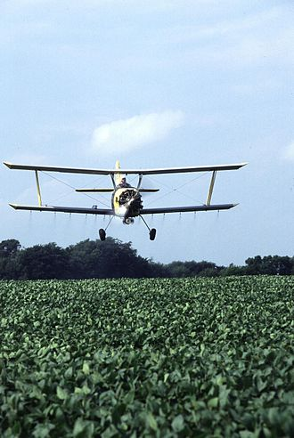 Soybean - Biplane cropduster over US soybean field