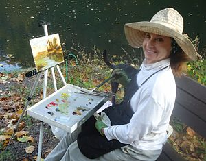 Mountainside, New Jersey - A landscape artist paints an autumnal scene at Echo Lake Park in Mountainside.