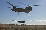 Australian Army CH-47 Chinook lifts a M777A2 Howitzer during Exercise Predator Strike at Cultana Training Area June 12, 2016 - cropped.jpg