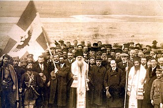 Autonomous Republic of Northern Epirus - Picture of the official declaration of Independence on 1 March 1914. President Georgios Christakis and members of the Government, bishops Vasileios and Spyridon as well as local clergy, military personnel and civilians are seen in the front.