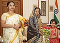 Baby Sarjana of Kolkata meeting the President, Smt. Pratibha Devisingh Patil, at Rashtrapati Bhavan with some of money collected by her for the victims of Cyclone Aila which was recently in West Bengal, in New Delhi.jpg