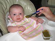 File:Baby eating baby food.jpg baby eating baby food