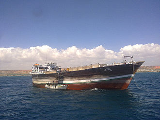 Barawa - Exporting Charcoal by Indian boat