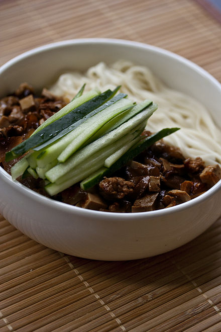 Zhájiàng Miàn (noodles with bean paste) is a traditional northern Chinese dish. It has spread to South Korea where it is known as Jajangmyeon.