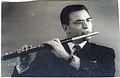 Bixio Daini in una foto del 1954 col suo flauto Ruddal-Carte con testata in argento.jpg