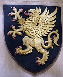 The Badge, roughly shield-shaped, shows a gold griffin on a black background