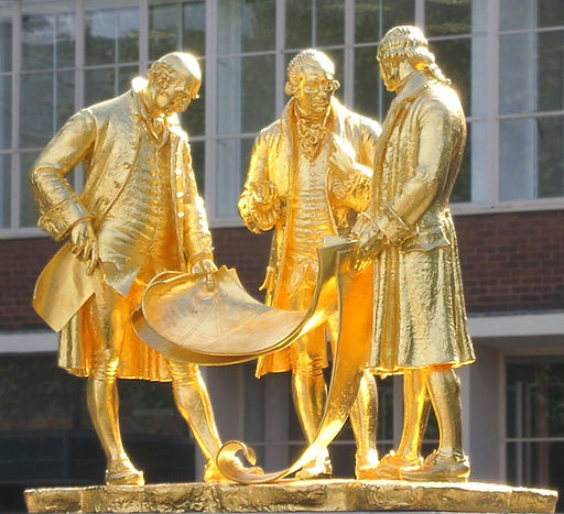 Gilded statue of three men