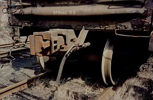 Railroad Safety Appliance Act - Modern US boxcar showing automatic coupler, air brake hose and grab bars, all mandated by the Safety Appliance Act