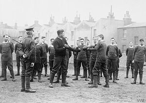 1st Surrey Rifles - Lance Corporal Pat O'Keefe spars with a private of the 21st (County of London) Battalion, London Regiment (First Surrey Rifles) in Camberwell, London, in 1914 (IWM Q53492)