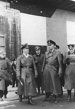 Rommel and Vice Admiral Friedrich Ruge visiting the U-boat base in La Rochelle, France, February 1944 Bundesarchiv Bild 146-1974-132-28A, Atlantikwall, Erwin Rommel mit Admiral Ruge.jpg