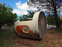 A 'bunker' style bus shelter on its side in the Canberra suburb of Campbell