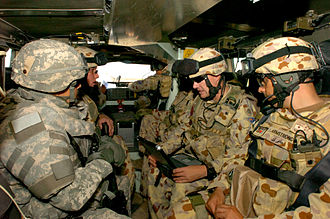 Bushmaster Protected Mobility Vehicle - Australian and United States Army personnel inside a Bushmaster