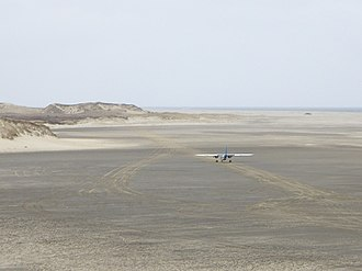 Sable Island Aerodrome - Sable Aviation's Britten Norman Islander parked on the beach runway