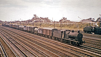 Rail freight in Great Britain - A pre-World War II LMS Fowler Class 4F steam locomotive hauling a mixed freight train at Carnforth in 1964.