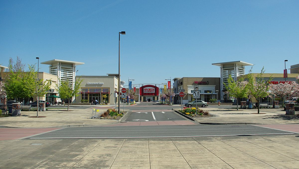 a road entrance to Cascade Station facing Sports Authority