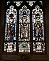 Castle Hedingham, St Nicholas' Church, Essex England, stained glass window, Dorcas, St Nicholas and St Luke in north aisle.jpg