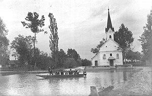 Cerkev Sv. Fabijana in Sebastjana ob naraslem potoku Gabernica, Mostec pri Brežicah.jpg