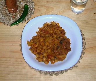 Cuisine of Algeria - Chakhchoukha: Marqa mixed with Rougag on individual plate ready to eat