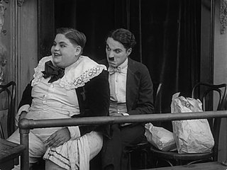 File:Charles Chaplin and Dee Lampton in A Night in the Show (1915 ...