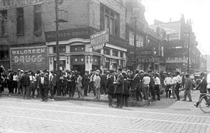 Chicago race riot of 1919 - African American men in front of Walgreen Drugs (now called Walgreens) at 35th and S. State St. in the Douglas community area.