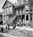 Chicago race riot, house with broken windows and debris in front yard.jpg