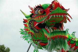 Dragon dance Traditional dance in Chinese culture performed by a team of dancers who manipulate a long flexible figure of a dragon