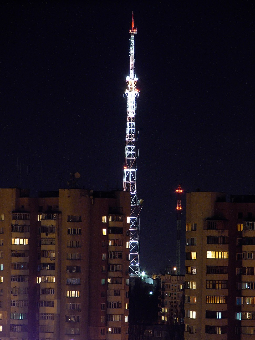 Chisinau TV tower at night, NIT TV tower in background