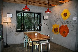 The 1st Shop of Coffee Prince - The interior of The 1st Shop of Coffee Prince featuring the wall flowers painting