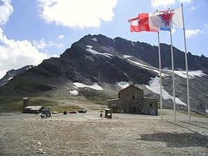 Col de l'Iseran - Wind-whipped flags at the summit in 2005
