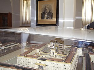 Conrad Schick - Schick's model of Herod's Temple on the Temple Mount, Schmidt School, Jerusalem, with portrait of Schick in the background