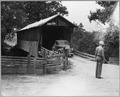 Coosa Valley, Alabama. Covered bridge entrance to reservation - Childersburg. - NARA - 522655.tif
